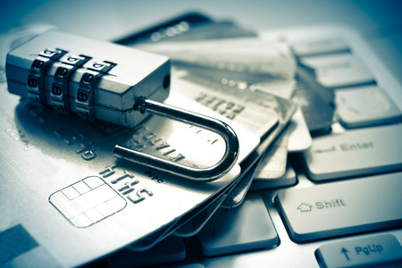 Photo pour open security lock on credit cards with computer keyboard - credit card data theft - image libre de droit