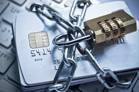 chained credit cards security lock with password - phishing protection concept