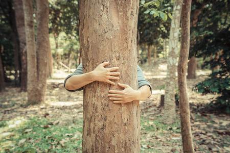 man hugging a big tree  love nature concept