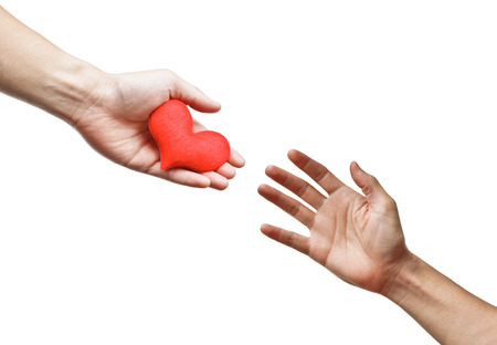 hand giving a red heart to other people
