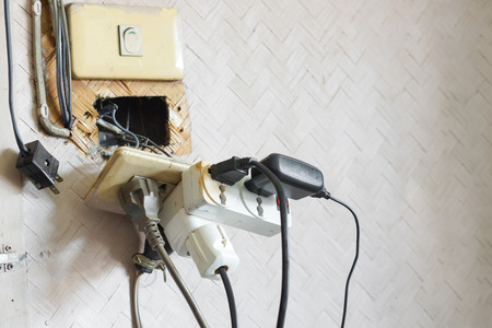 Photo pour Too many plugs in a socket / Danger of using too much electricity - image libre de droit