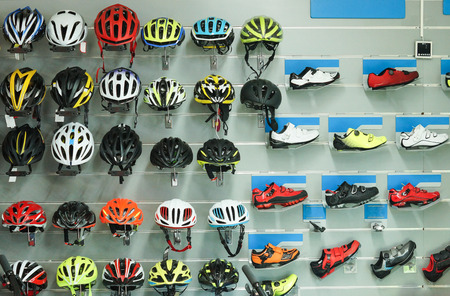 Photo for Bicycle helmets and shoes on shelves - Royalty Free Image