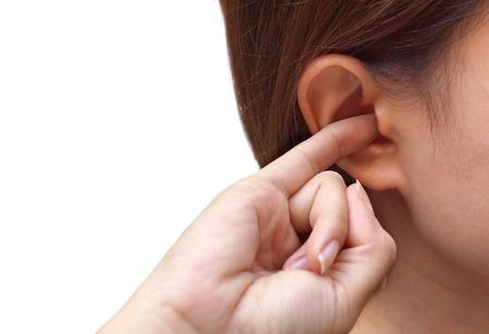 Foto für Woman putting a finger into her ear / Itchy ear isolated - Lizenzfreies Bild