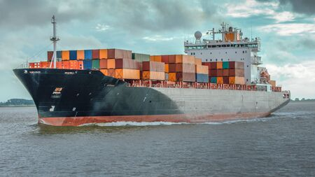 Photo for Container ship on the river Elbe by Hamburg - Royalty Free Image