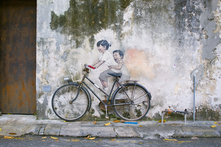 Little Children on a Bicycle or Sibling Cyclist Street Art Mural in Armenian Street, George Town, Penang Unesco Heritage Site by   Lithuanian artist Ernest Zacharevic
