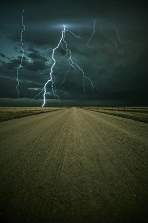 Lightning Storm Ahead - Colorado Plains Outback Road with Lightning Storm Ahead. Vertical Image. Nature Photo Collection.