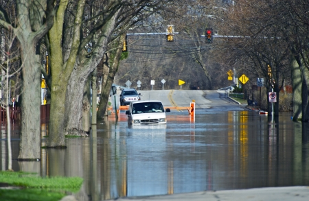 Flooded City Streets. Van in the Water. Heavy Rain River Flood in Chicago Metro Area. Nature Disasters Photo Collection.
