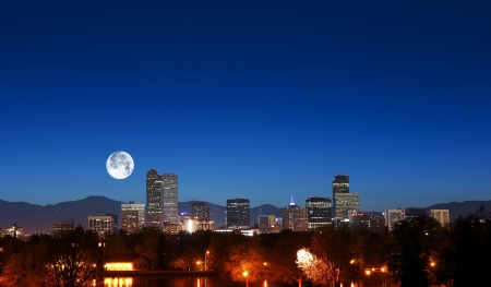 Denver Skyline with Moon. Downtown Denver and Rocky Mountains. American Cities Photo Collection.