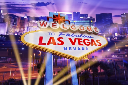Las Vegas Showtime Concept. Illuminated City and Vegas Strip Welcome Sign. Famous City of Las Vegas, Nevada, United States.