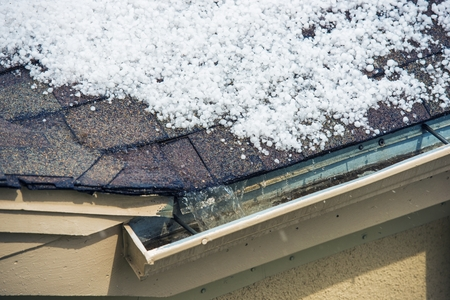 Small Melting Hail on the Roof. Severe Weather Concept.