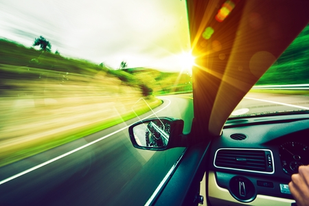 Photo pour Driving Down the Road. Road to the Sun. Modern Car Driving.  - image libre de droit