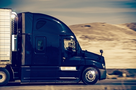 Foto de Speeding Dark Blue Semi Truck in Nevada, United States. Trucking in Western USA. - Imagen libre de derechos