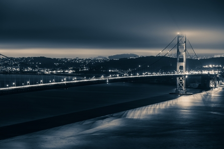 Golden Gate Night Theme. Golden Gate Bridge and San Francisco Panorama in Dark Blue Color Grading.