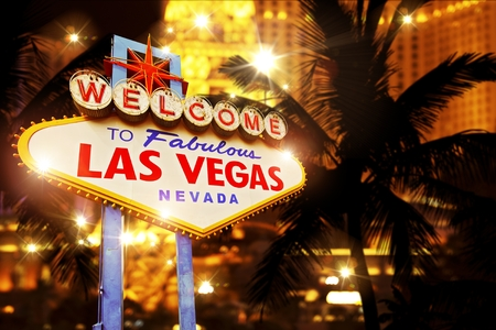 Hot Night in Las Vegas. Vegas Heat Concept Image with Las Vegas Welcome Sign and Strip Lights.