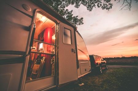 Photo pour Travel Trailer Camping. RV Trip Theme. Evening in RV . Vintage Color Grading. - image libre de droit