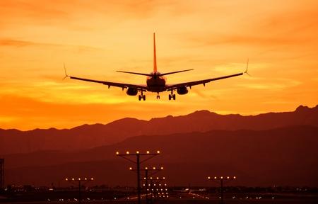 Landing Airplane at Sunset. Las Vegas International Airport, Nevada, United States. Air Transportation Theme.