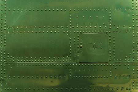 Photo pour Rivets and Metal Dark Green Painted. Metal Military Grade Backdrop - image libre de droit