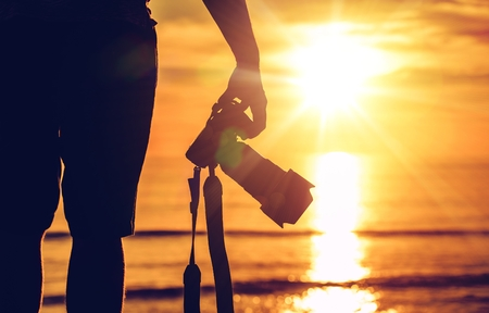 Photo for Sunset Photography. Photographer Ready to Take Sunset Pictures on the Beach. Professional Travel Photography Works. - Royalty Free Image