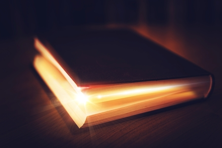 Book of Mysteries. Old Book with Glowing Content. Magical Book.
