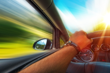 Photo for Fast Car Driving Photo Concept. Vehicle Traveling. - Royalty Free Image