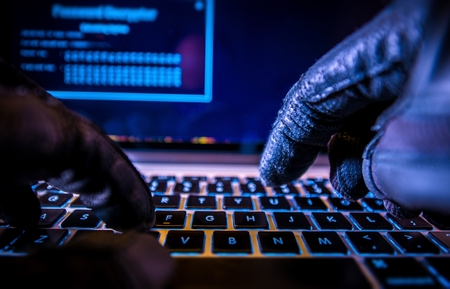 Foto de Payments System Hacking. Online Credit Cards Payment Security Concept. Hacker in Black Gloves Hacking the System. - Imagen libre de derechos