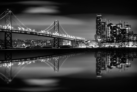 Photo for The San Francisco Bay at Night in Black and White. Bay Bridge and San Francisco Skyline. Monochrome. - Royalty Free Image