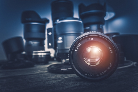 Camera Lens and Photography Equipment in the Background. Photography Concept Photo.