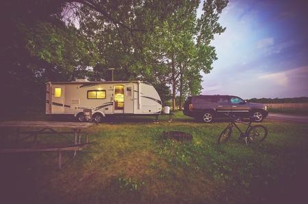 Foto de RV Camping Adventure. SUV Pulling Travel Trailer. - Imagen libre de derechos