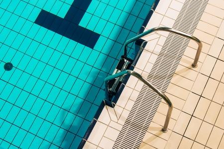 Swimming Pool Metallic Ladder Closeup Photo. Indoor Swimming Pool.