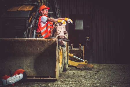 Photo pour The Man and the Machine. Bulldozer and Excavator Operator Break at Work. Professional Caucasian Construction Machines Operator. - image libre de droit