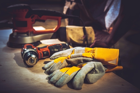 Photo pour Home Remodeling Works. Construction Tools and Safety Gloves. - image libre de droit