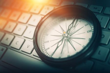 Photo pour The Internet Navigator Concept Photo. Vintage Metallic Compass on the Computer Keyboard. Navigation Through the Internet. - image libre de droit