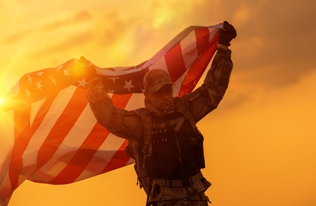 Photo for Soldier Celebrating Victory Running with Large American Flag. Trooper with the Flag. - Royalty Free Image