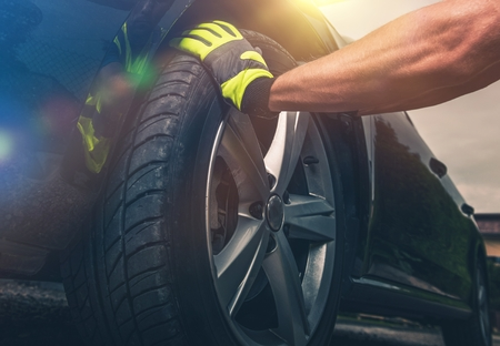 Photo for Flat Tire Replacing Closeup Photo. New Tire For the Modern Vehicle. - Royalty Free Image