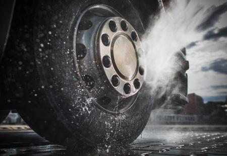 Foto de Semi Truck Wheels High Pressured Water Washing Closeup Photo. - Imagen libre de derechos