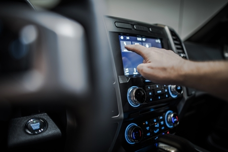Photo pour Setting Up Modern Vehicle Multimedia System. Streaming Audio in a Car. - image libre de droit
