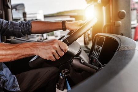 Foto de CDL Commercial Driver Inside of His Truck. Transportation Industry Theme. - Imagen libre de derechos