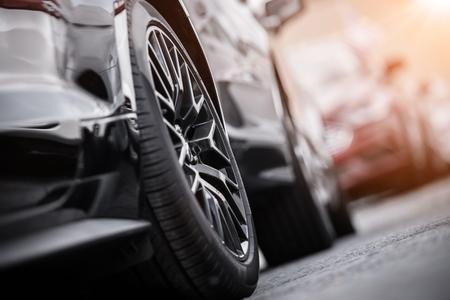 Photo pour Modern Car on the Parking. Alloy Wheel Closeup. Automotive and Transportation Concept. - image libre de droit