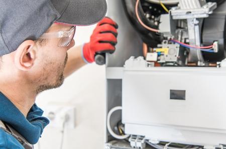 Photo pour Central Natural Gas Heater Repairing by Professional Caucasian Heating Technician. - image libre de droit