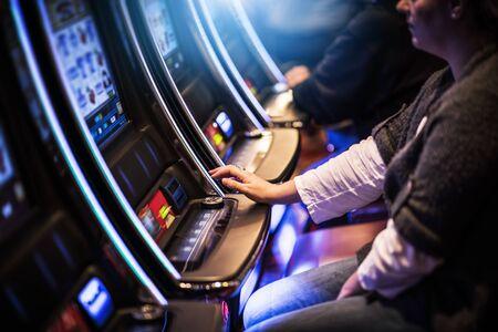 Photo pour Casino Slot Gamblers. People Playing Video Slot Machines Inside Las Vegas Located Casino. - image libre de droit