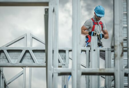 Photo for Construction Business Industry. Caucasian Skeleton Frame Worker in His 30s. Safety Harness. - Royalty Free Image