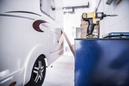 Photo pour Camper Van RV Repair Concept. Recreational Vehicle in the Service Center. Drill Driver Power Tool. - image libre de droit