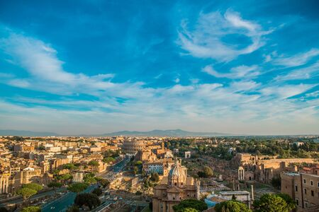 Foto per Rome Italy Summer Time Cityscape. Colosseum and the Roman Forum. Popular European Destination. Clear Sky with Some Clouds. - Immagine Royalty Free