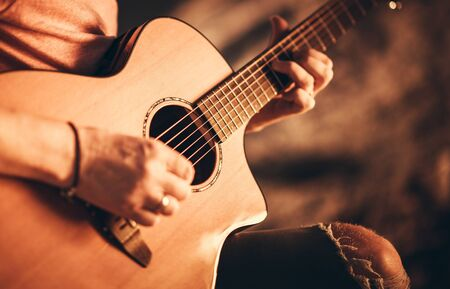 Photo for Caucasian Singer Musician with Classic Acoustic Guitar. Guitar Ballad Playing Closeup Photo. - Royalty Free Image