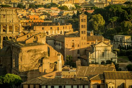 Foto per Rome Historical Places. Roman Forum Ruins and Colosseum. Ancient Government Buildings in the Center of Rome, Italy. - Immagine Royalty Free