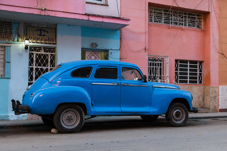 Cuban hand-brake securing an old timer early one morning in Centro Havana.