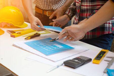 Foto de Team Architect drawings blueprint at Construction Site.concept - Imagen libre de derechos