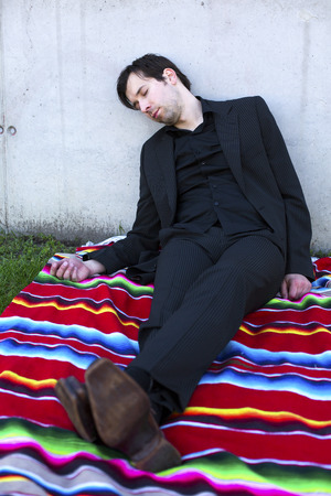 businessman passed out on a blanket outdoors