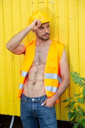 Photo for portrait of sexy shirtless worker with yellow construction helmet - Royalty Free Image