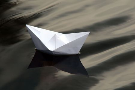 Paper boat sailing alone